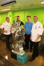 Christophe just finished testing his ice carving with Derek Maxfield and Randy Finch